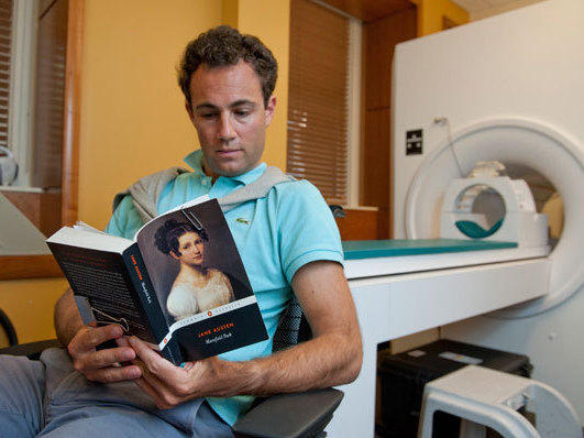 Matt Langione, a subject in the study, reads Jane Austen's <em>Mansfield Park</em>. Results from the study suggest that blood flow in the brain differs during leisurely and critical reading activities.