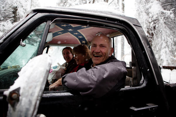 From left, Dale McKey, Karin McKey and George Secrist return home from an outing into the snow on Tuesday.