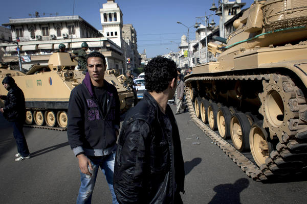 Egyptian Army tanks deploy near the presidential palace after clashes that left several people dead and hundreds wounded.