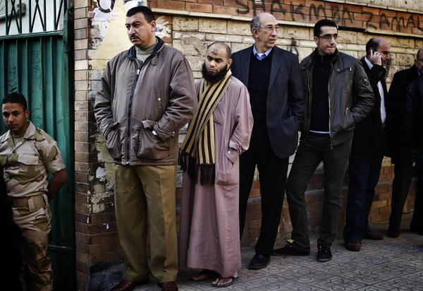 Egyptians wait in line to vote on a new draft constitution in Giza, south of Cairo, on Saturday.