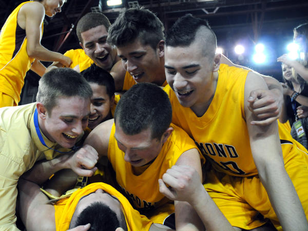 Members of the boys basketball team from Dimond High School in Anchorage, Alaska, celebrate their 2012 state championship victory. Psychological research shows that sports camaraderie improves teenagers' mental health.