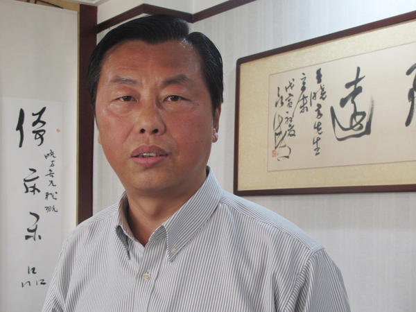 """Former civil servant Wang Xiaofang is the author of 13 books on """"bureaucracy literature,"""" including <em>The Civil Servant's Notebook</em>, which recently was translated into English."""