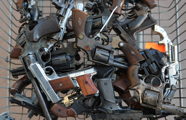 """Handguns collected in South-Central Los Angeles as part of a Gun for Gift Card exchange in 2009. One teenager here says getting a gun on the streets is just """"one phone call away."""""""
