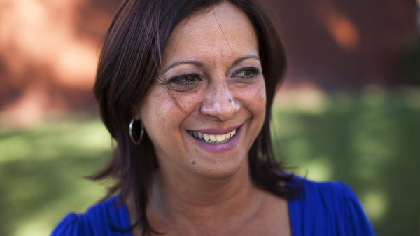 Arlene Bonet settled in Orlando, Fla., after her Puerto Rico real estate business crashed. She's now working for a Puerto Rican cultural organization in Orlando, while her son and mother still live in her hometown, Cabo Rojo, Puerto Rico.