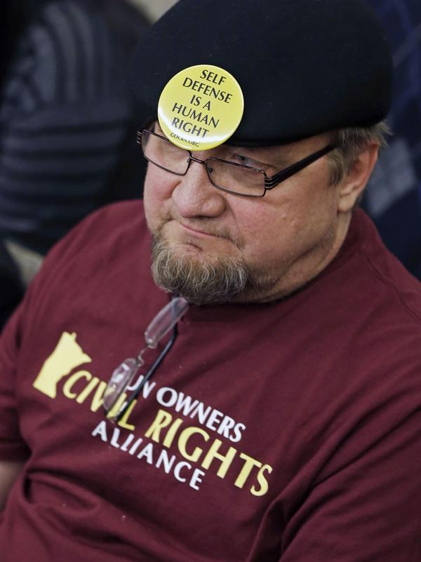Gun rights advocate Andy Cers of Minneapolis listens to testimony during a Minnesota House hearing on gun violence bills Tuesday in St. Paul.