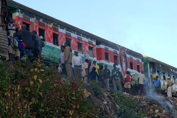 Morning commuters at Kibera train station board a train that became colorful overnight.