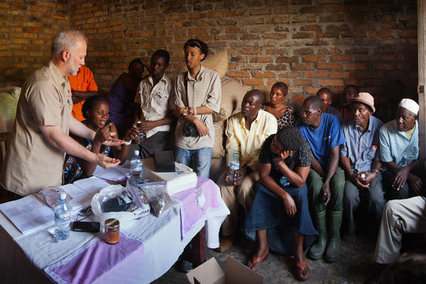 """Shawn Askinosie, founder of Askinosie Chocolate, buys cocoa beans directly from farmers, like this Uwate cocoa farmers group in Tenende, Tanzania. Dealing direct """"impacts the flavor of chocolate, and it brings the consumers closer to the producers,"""" Askinosie says."""