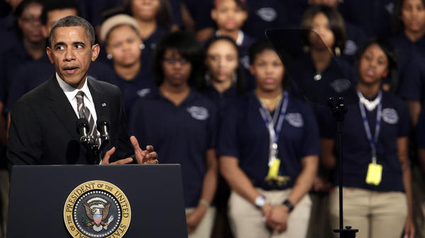 President Obama speaks about strengthening the middle class and the nation's struggle with gun violence at Hyde Park Academy in Chicago on Friday.