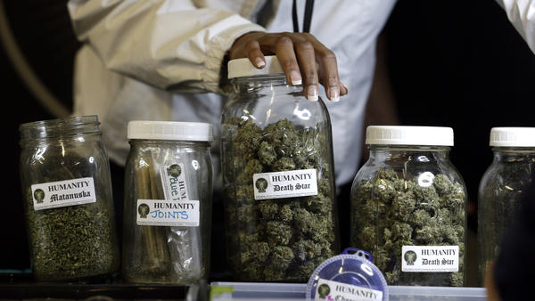 Medical marijuana on display at the grand opening of the Northwest Cannabis Market's Seattle location in February. While recreational pot use is now legal in Washington, the state has not yet issued rules governing the industry.