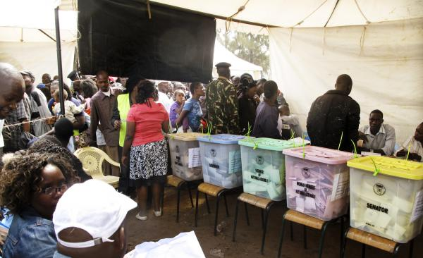 """Kenyan election observers and voters in the mixed slum of Kiambiu — where the first fires started in Nairobi after the disputed presidential election of 2007 — vote in this year's elections. Could something as innocent as the color of the ballots and ballot boxes be contributing to voting """"irregularities""""?"""