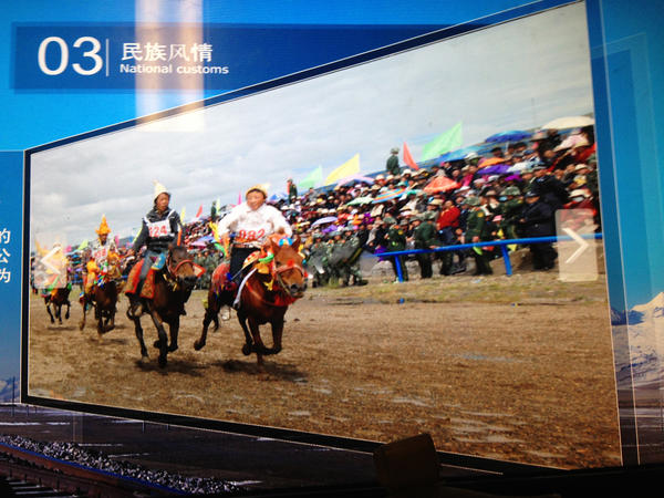 """A close look at a photo of the Nagqu horse festival in northern Tibet at the National Museum of China in Beijing reveals a gaggle of surprising """"spectators"""" at the traditional Tibetan event: Chinese paramilitary police (see enlargement)."""
