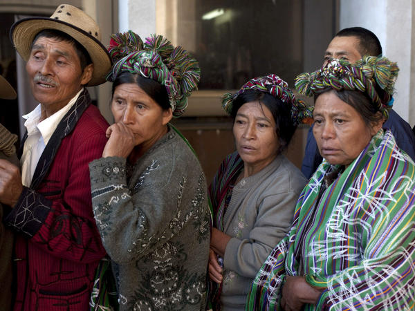 Members of the Ixil ethnic group who lost relatives in a massacre during Guatemala's long civil war wait to enter a courtroom where former ruler Efrain Rios Montt (1982-1983) faces charges of genocide.