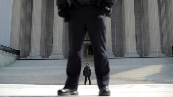 Police stand guard in front of the U.S. Supreme Court on Wednesday as the justices hear arguments on the constitutionality of the federal Defense of Marriage Act.