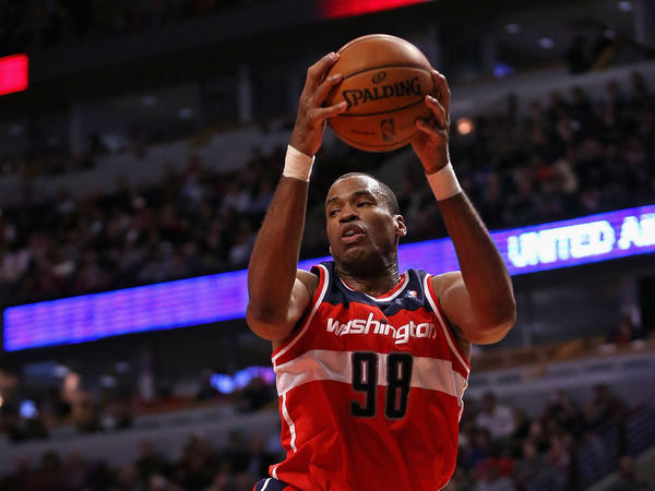 Jason Collins of the Washington Wizards rebounds against the Chicago Bulls at the United Center earlier this month in Chicago.