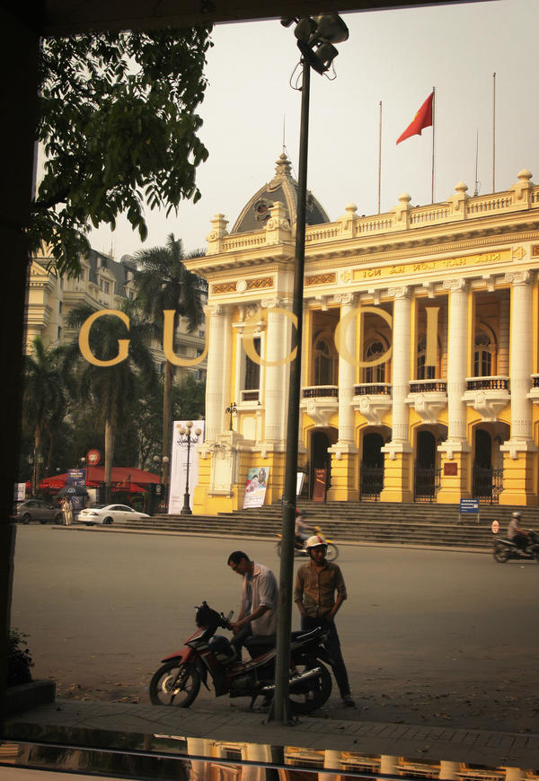 The rise of Vietnam's economy — captured in the reflection of Hanoi's famed opera house in this Gucci boutique — threatens the survival of rhinos thousands of miles away in South Africa.