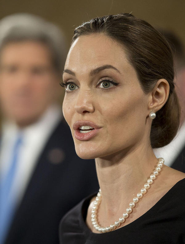 Actress Angelina Jolie at a news conference with Secretary of State John Kerry (in background) and other foreign ministers in London last month. They held a forum on how to reduce sexual violence against women in conflict zones — an issue she has often spoken about.