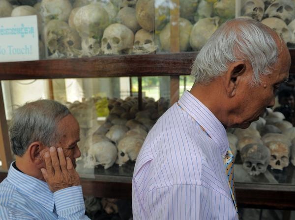 Cambodian survivors of the Khmer Rouge-era Tuol Sleng prison, also known as S-21, at the Choeung Ek killing fields memorial in Phnom Penh in 2011.