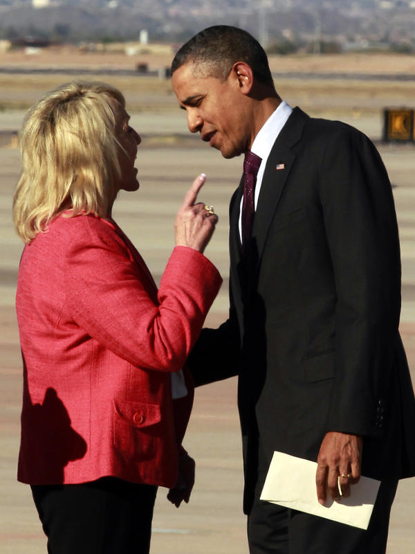Arizona Gov. Jan Brewer, a Republican, points during an intense conversation with President Obama after he arrived at Phoenix-Mesa Gateway Airport in Mesa, Ariz. She has since made light of the incident in trying to rally support for a Medicaid expansion in the state.