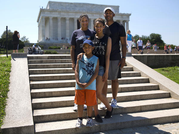 Kara, Michael, Mikaila and Cameron Milton of Greensboro, N.C., pose for a portrait near the Lincoln Memorial on June 21, after reading the Declaration of Independence for <em>Morning Edition</em>.