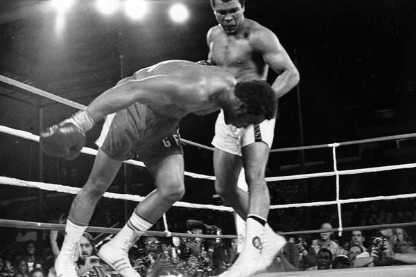 Ali watches as defending world champion George Foreman goes down to the canvas in the eighth round of their WBA/WBC championship boxing match in Kinshasa, Zaire, on Oct. 30, 1974. Foreman was counted out by the referee and Ali regained the world heavyweight crown by knockout.