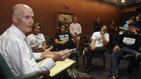 Florida Gov. Rick Scott speaks to protesters Thursday in the Capitol in Tallahassee. Scott told the protesters that he won't ask lawmakers to revamp the state's controversial self-defense law.