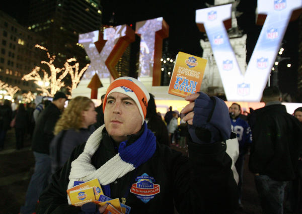 Super Bowl volunteer Ben Schreiber distributes fan guides to any of the thousands of people who may need them while visiting Indianapolis for Super Bowl XLVI festivities, in 2012.