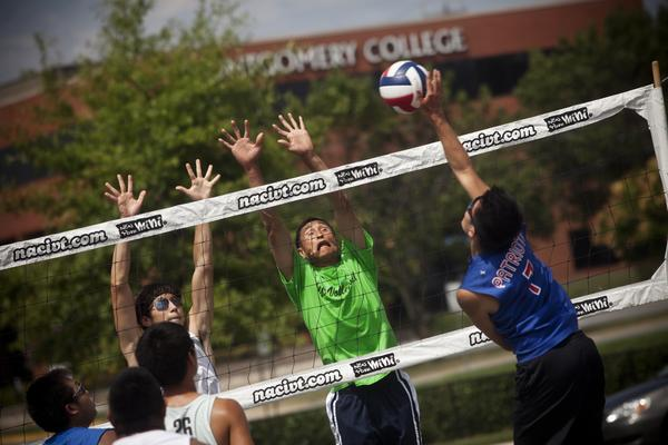 Sam Li, 52 (in green) has been playing volleyball for nearly 30 years and keeps up with the younger players.