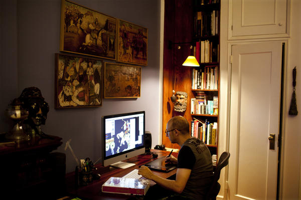 The wall above Rahmanian's desk is adorned with wooden reliefs of stories from the <em>Shahnameh</em>, depicted in a style known as Ghahve Khane. Rahmanian says looking up at the images while he worked would rest his eyes and offered a reprieve from the computer screen.