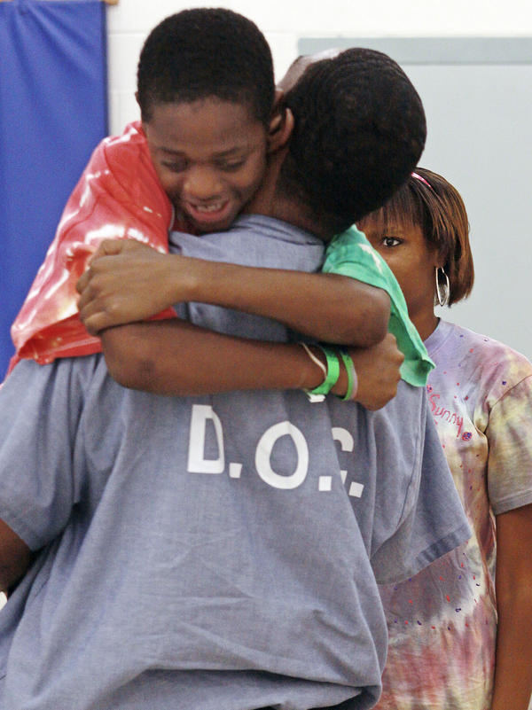 In the Father to Child Summer Camp Behind Bars program, kids can bond with their fathers while staying at a campground near prison.  Geray Williams, an inmate at the North Branch Correctional Institution in Cumberland, Md., gets a hug from his son Sanchez during the weeklong camp in 2010.