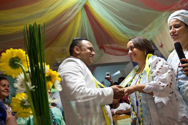 The couple exchange wedding rings.