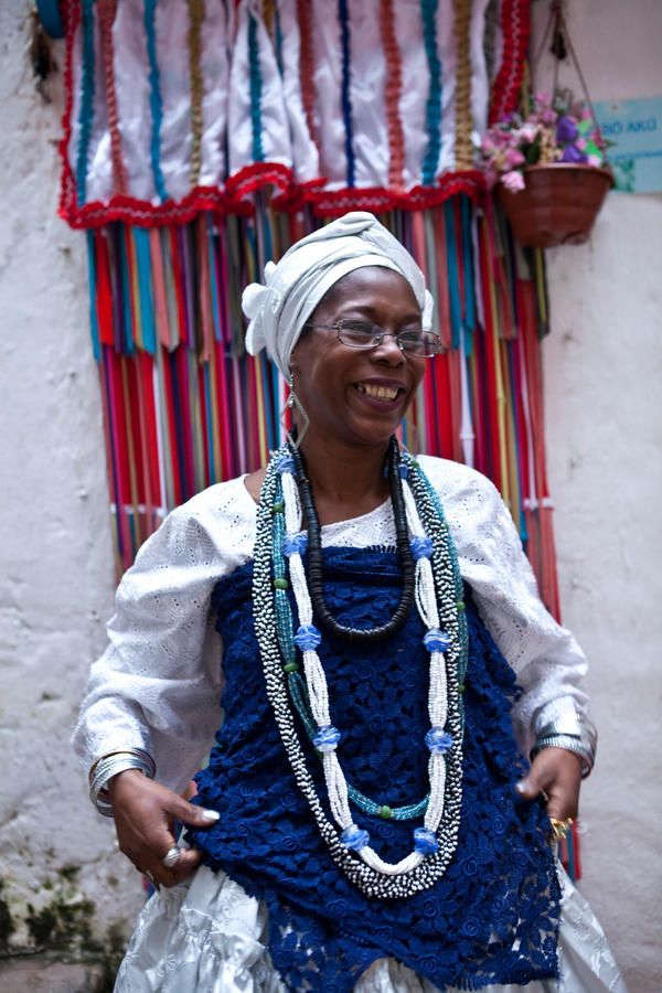 A Candomblé practitioner gets ready for the party outside the temple.
