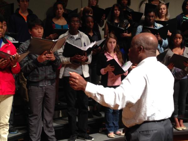 Fisk Jubilee Singers musical director Paul Kwami directs young singers during his residency at Durham School of the Arts.