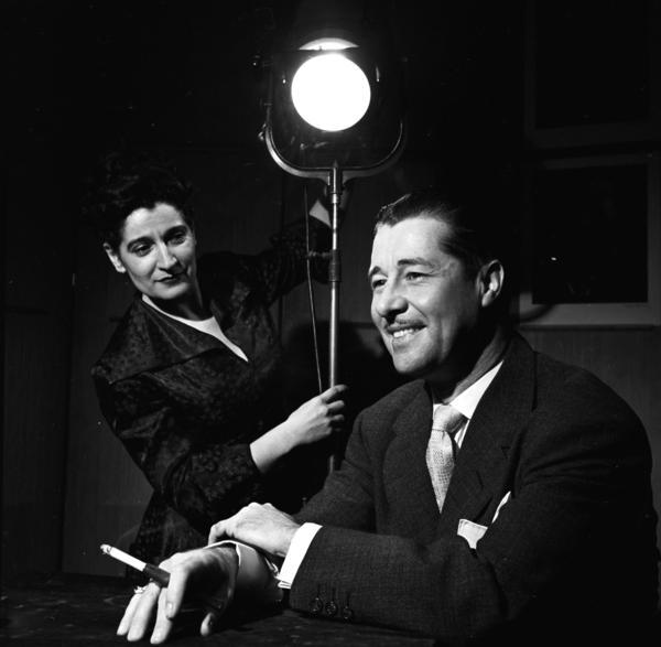 Celebrity photographer Editta Sherman photographs actor Don Ameche in her studio circa 1950.