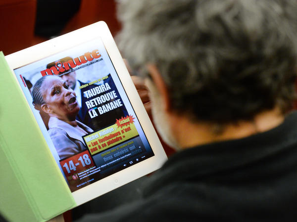 """The Nov. 13 issue of the French far-right weekly magazine <em>Minute</em>, with a picture of Justice Minister Christiane Taubira. Translated, the headline reads: """"Clever As A Monkey."""""""