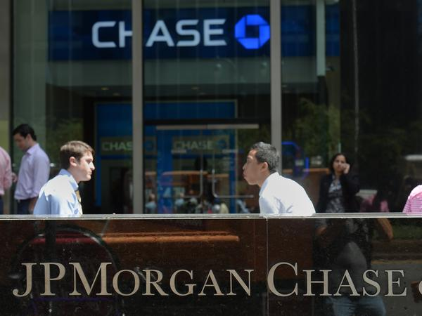 People walk by JPMorgan Chase & Co. headquarters in New York, in August.