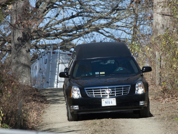 """A hearse leaves the Deeds family home in Millboro, Va., on Tuesday, after 24-year-old Austin """"Gus"""" Deeds died in an apparent suicide."""