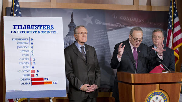 Senate Majority Leader Harry Reid of Nevada (from left), Sen. Charles Schumer, D-N.Y., and Senate Majority Whip Richard Durbin of Illinois defend the Senate Democrats' vote Thursday to weaken filibusters and make it harder for Republicans to block confirmation of the president's nominees for judges and other top posts.