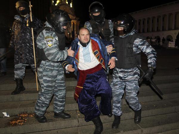 Ukrainian riot police officers detain an activist during a rally demanding the resignation of President Viktor Yanukovych.