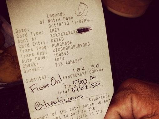 """One of the two checks that """"TipsForJesus"""" signed at a restaurant in South Bend, Ind., on Oct. 19. The anonymous givers added $5,000 to each of the bills."""