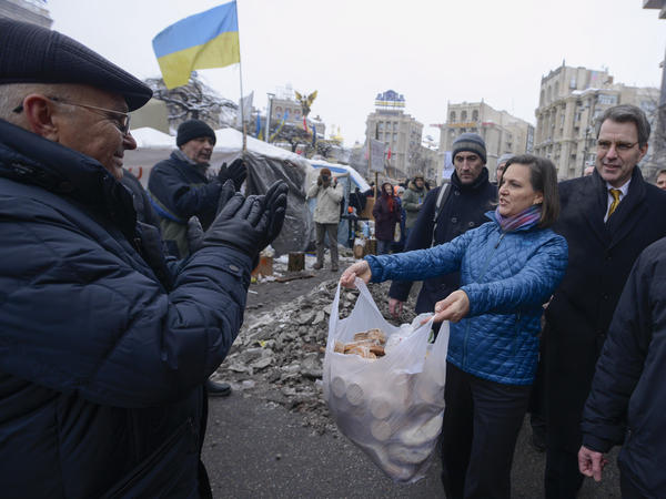 U.S. Assistant Secretary for European and Eurasian Affairs Victoria Nuland offered food to pro-European Union activists as she and U.S. Ambassador to Ukraine Geoffrey Pyatt, right, walked through Independence Square in Kiev, Ukraine, on Wednesday. She also offered food to some of the police nearby.