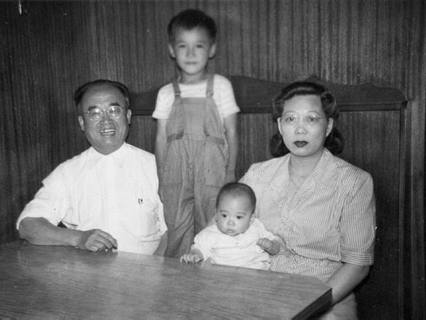 """William Wong (standing) poses with his parents and nephew in an old family photo. Wong's mother immigrated to the U.S. from China as his father's """"sister"""" to bypass the Chinese Exclusion Act of 1882."""