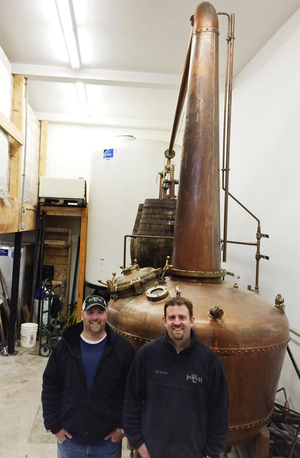 Evan Parker and Mat Perry of Turkey Shore Distilleries with their 400-gallon copper kettle and still.