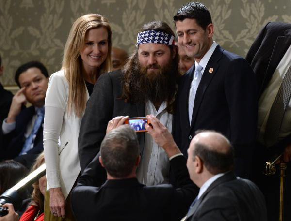 Korie Robertson (left) and Willie Robertson of the television show <em>Duck Dynasty</em> pose for a picture with Rep. Paul Ryan, R-Wis.