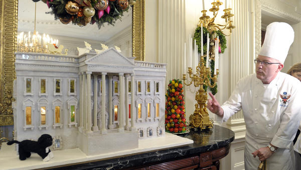 Among Bill Yosses' many confectionary creations for the first family: this nearly 300-pound gingerbread model of the White House, on display in the State Dining Room in November 2012. The house featured not just Bo, the family dog, but also a vegetable garden.