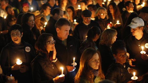 A candlelight march honors Sarah Jones, a camera assistant who was killed by a train in February while shooting the film <em>Midnight Rider</em>.