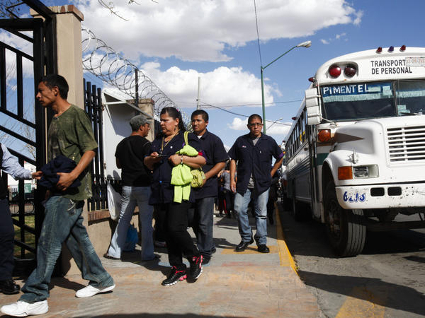 Workers arrive at an assembly plant located along the border.