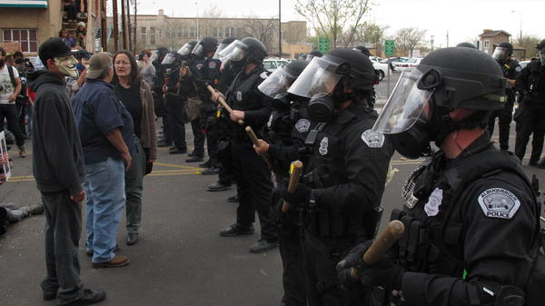 Riot police faced off with protesters Sunday, during a demonstration against recent police shootings in Albuquerque, N.M. The march lasted at least nine hours.