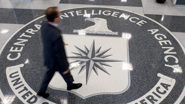 A group of 3,000 ordinary citizens, armed with nothing more than an Internet connection, is often making better forecasts of global events than CIA analysts. Here, a man crosses the CIA logo at its headquarters in Langley, Va.