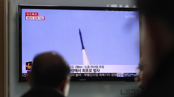 A person in Seoul, South Korea, watches a television report on a North Korean missile launch on March 26. In the U.S., some participants in the Good Judgment Project are proving far more accurate than intelligence analysts in predicting such events.