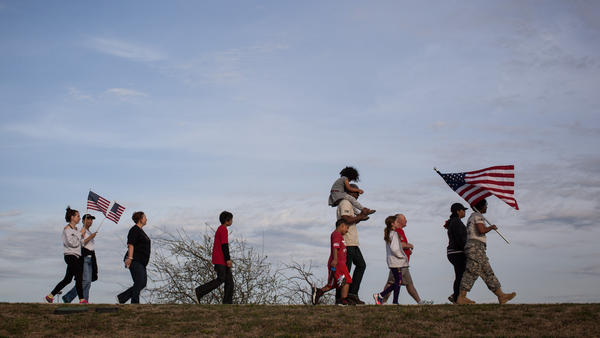 Active members of the military, veterans and civilians march through Lions Club Park to pay tribute to the victims and families affected by the Fort Hood shooting Friday in Killeen, Texas.